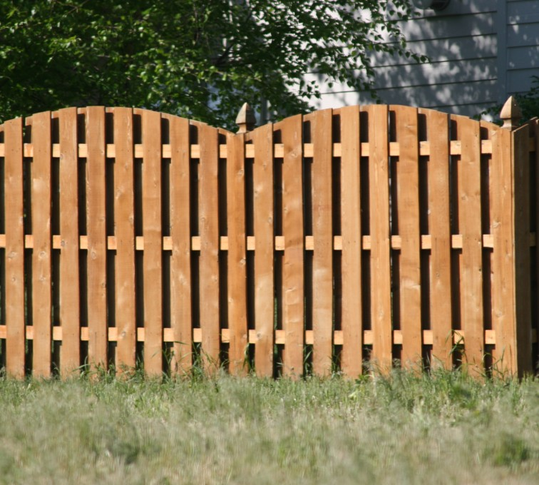 The American Fence Company - Wood Fencing, 1015 6' overscallop board on board stained