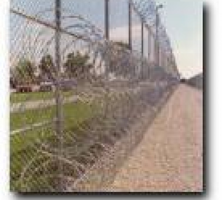 The American Fence Company - High Security Fencing, 2105 concertina wire 3 coils