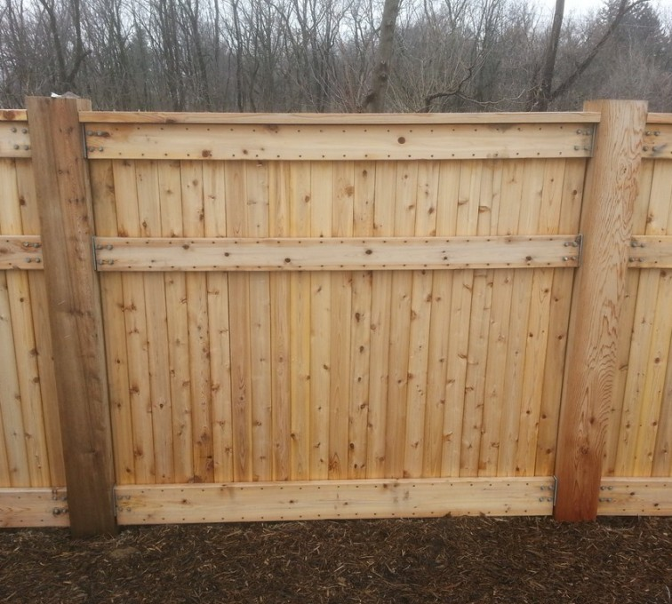 The American Fence Company - Wood Fencing, 6' Custom Wood With Stone Columns - AFC- IA