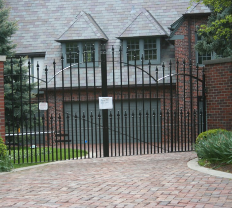 The American Fence Company - Custom Gates, Double Drive Over Arch Gate With Puppy Accent