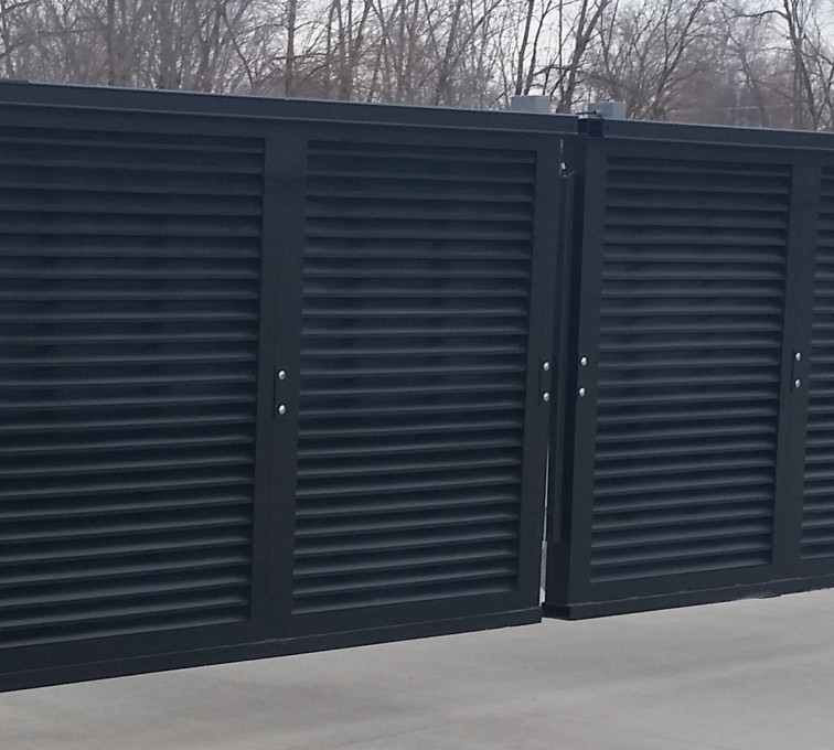 Louvered screen slide gates.