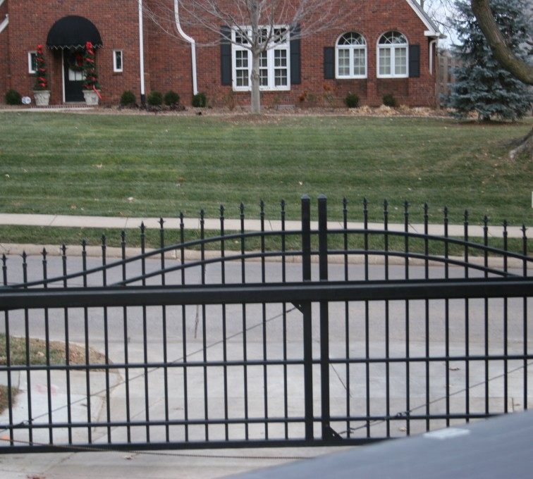 The American Fence Company - Custom Gates, Over Arch Cantilever Slide Gate