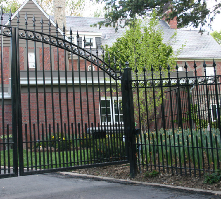 The American Fence Company - Custom Gates, Over Arch Gate with Puppy Accent