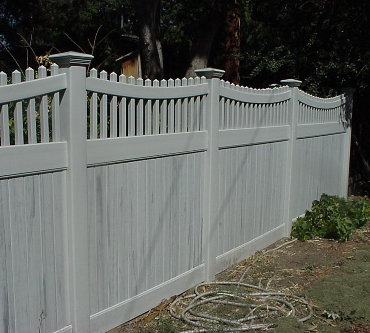 The American Fence Company - Vinyl Fencing, Privacy with Sloped Rail Picket Accent 703