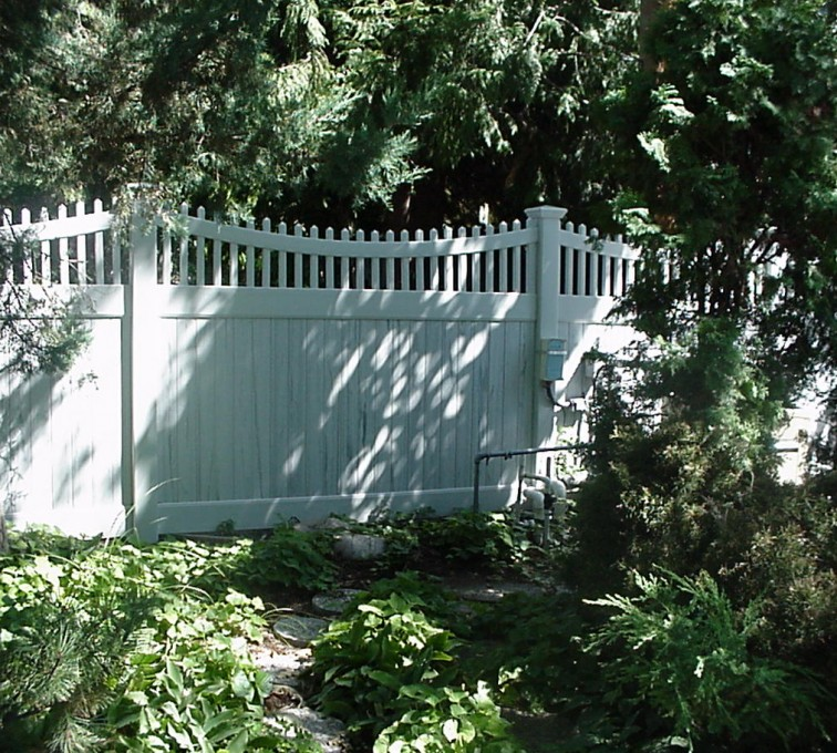 The American Fence Company - Vinyl Fencing, Privacy With Sloped Rail Picket Accent 704