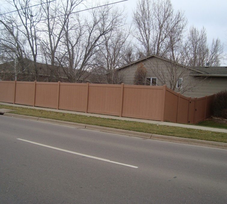 The American Fence Company - Vinyl Fencing, Solid Privacy Cedar Tone
