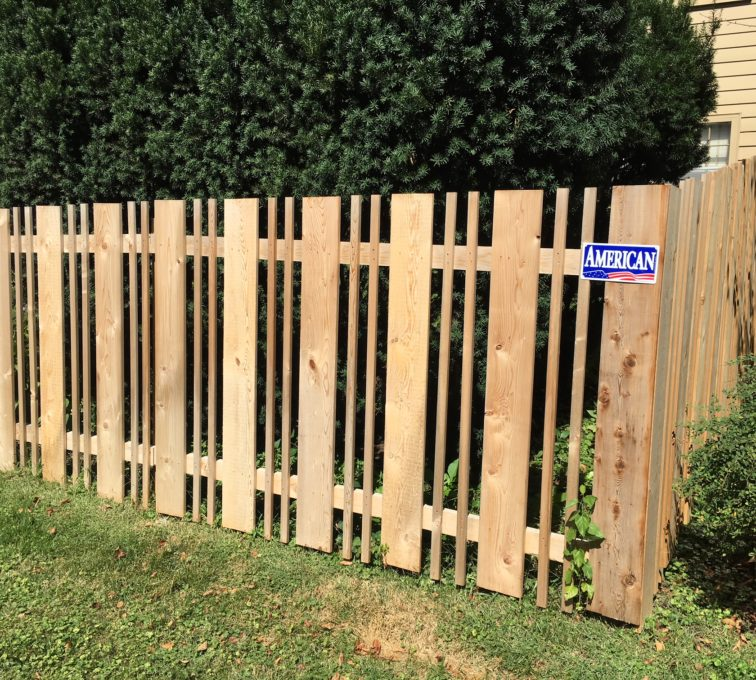 Wood alternating picket fence