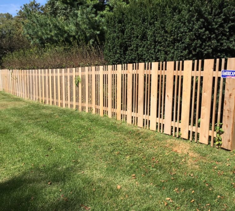 Custom alternating picket fence made of wood
