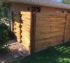 Custom wood fence set in a basket weave pattern