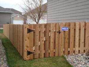 Wood board on board fence, residential backyard