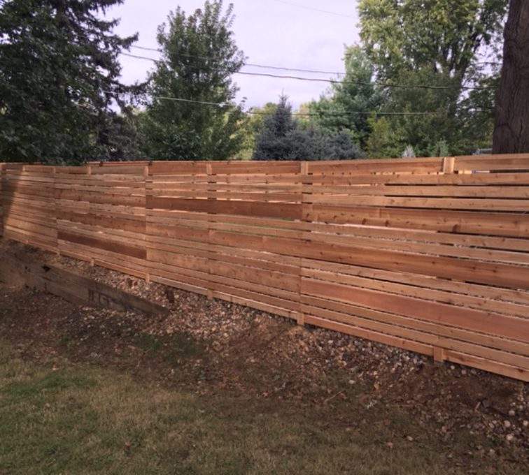 Fence made of horizontal wooden pickets