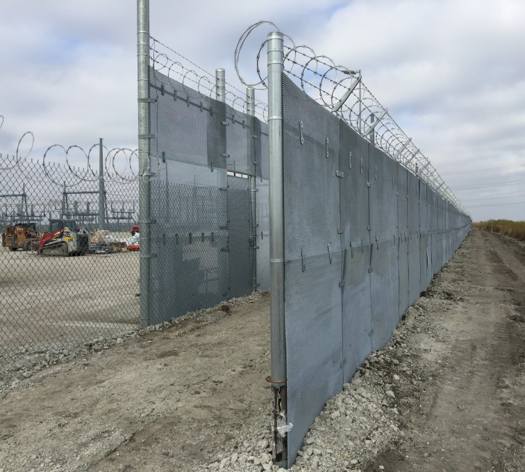 Two stretches of high security fence run parallel to each other. It is called deadman zone because it is figured if someone is to get over one fence they will get caught in the middle before they can get over the second fence. That or they will get shredded from trying to scale the barb and razor wire