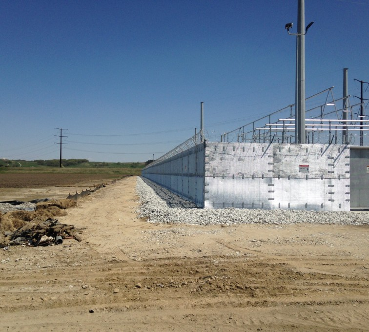 Ballistic fencing surrounding an electric facility from bullets and projectiles