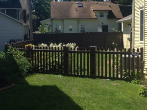 Chestnut brown vinyl picket fence, 4' tall