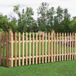 A French Gothic incense cedar picket fence on a bright green lawn