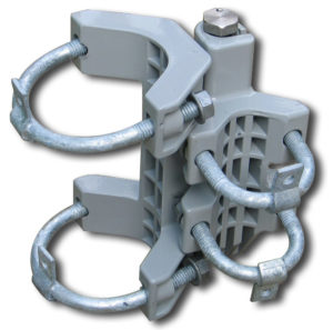 A universal self-closing spring hinge with 2 larger U-bolts on one side and 2 smaller U-bolts on the other