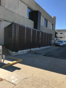 A PalmSHIELD louvered fence installed for the City of Los Angeles's Department of Water and Power for their mechanical equipment systems