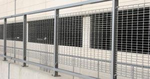 Aluminum bar grating panels near a parking garage structure