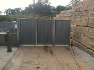 An outdoor entrance blocked off by 3 vertical louver panels