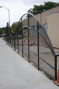 Custom black wire mesh screening shaped in curves and arches