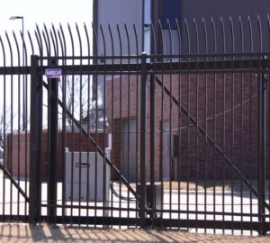 An American Fence Company access control operated ornamental iron cantilever gate