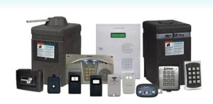 A selection of access control equipment, including operators, transmitters, key pads, photo eyes and other entry control