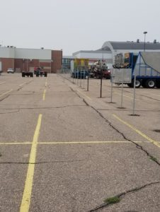 A shot of temporary fencing being installed by American Fence Company in the parking lot at the famous Nebraska State Fair
