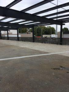 Composite perimeter parking area fence