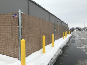 Privacy slats installed in a commercial chain link fence in Sioux City, IA