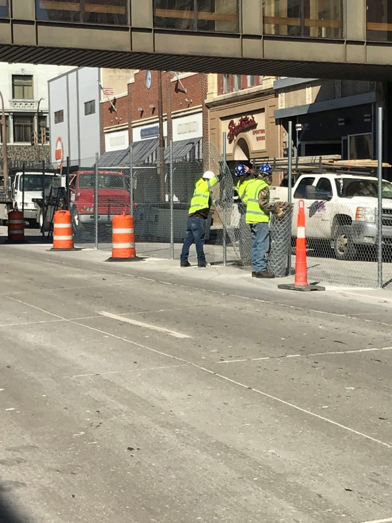 Sioux City installation crews putting in 8' tall temporary construction fence