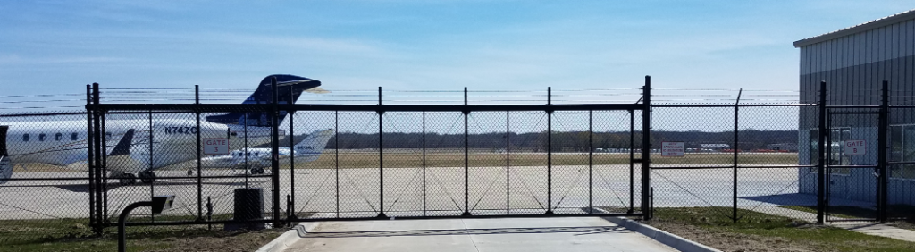 Airport fly grounds secured by high security ornamental cantilever sliding gate with barb wire and automated technology