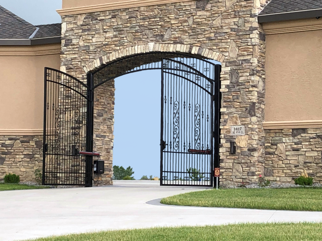 Double swing ornamental gates with gate operator at a personal residence