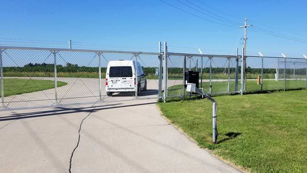 Commercial automated gate controlling access to a lot.