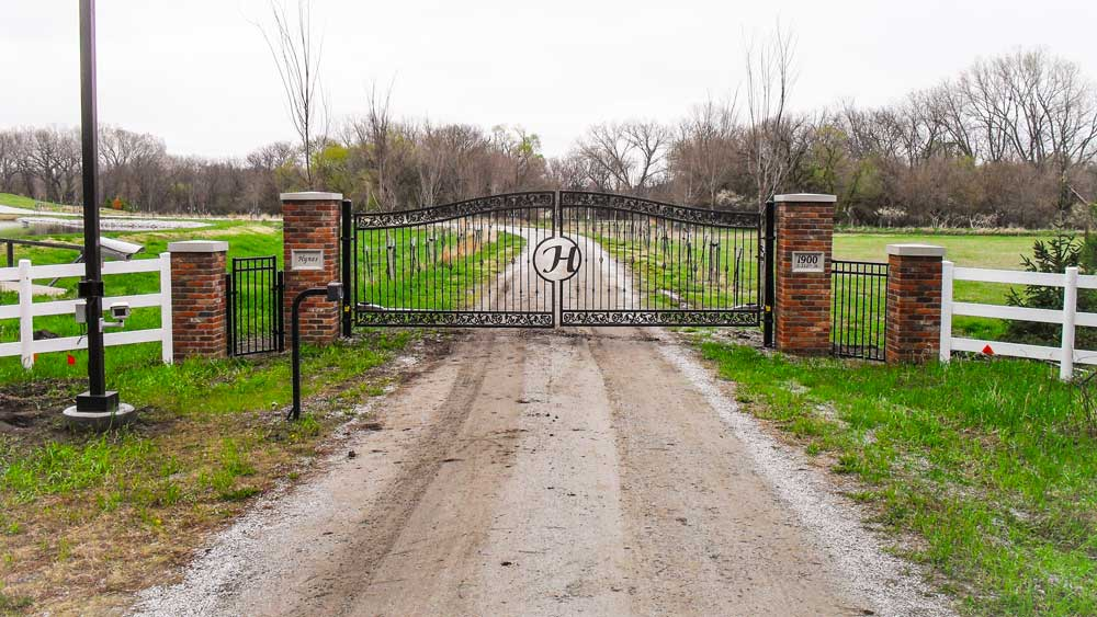 Custom metal ornamental automated gate for a residential property