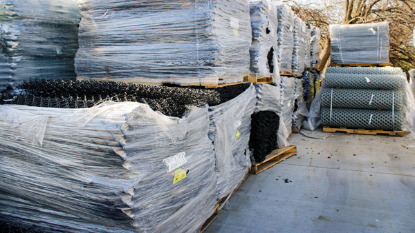 Stockyard inventory of chain link fabric.